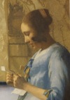 Woman in Blue reading a Letter